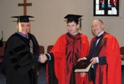 Преподаватель МБС Александр Попов получил докторскую степень